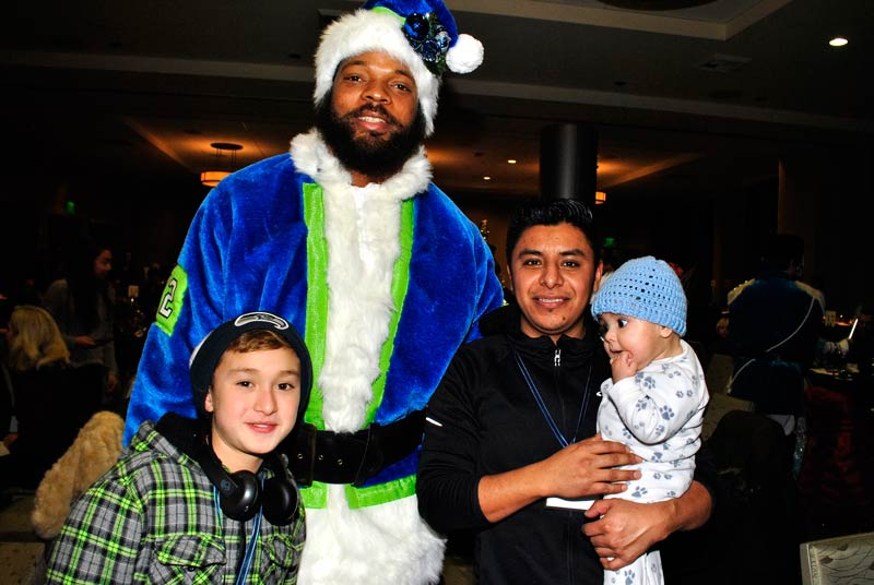 Seahawks Defensive End Michael Bennett with Bellevue LifeSpring family