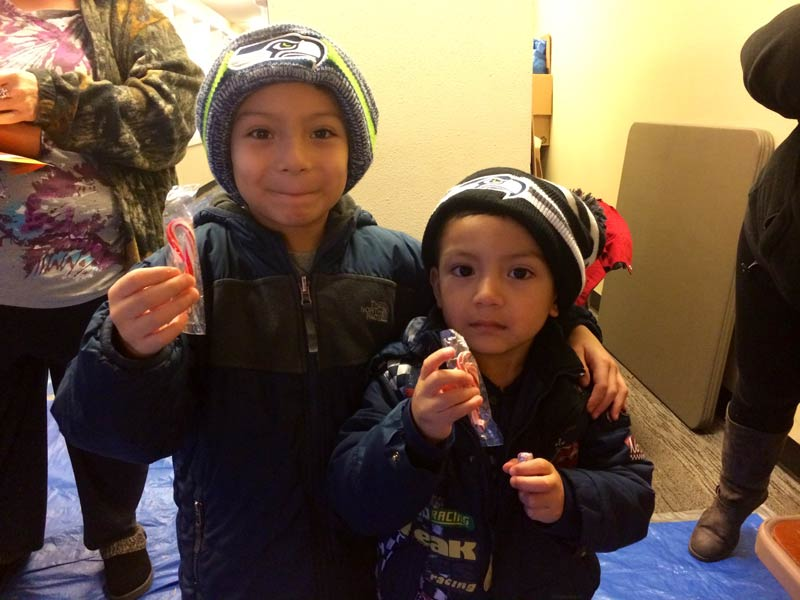 Holiday Adopt-A-Family kids with Seahawks hats