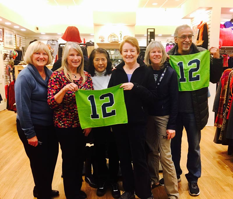 Thrift Culture volunteers with the 12th Man Flag